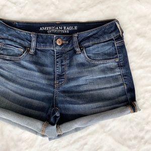 AE // stretch denim midi shorts medium wash